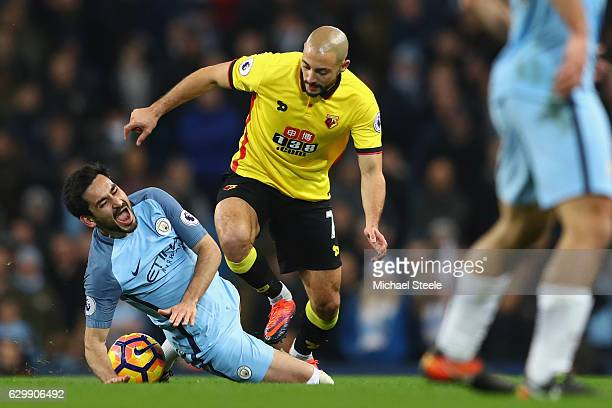 Ilkay Gundogan of Manchester City is fouled by Nordin Amrabat of Watford leading to Gundogan being substituted through injury during the Premier...