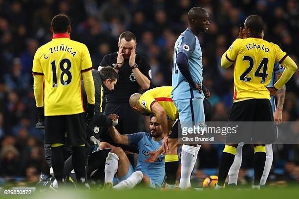 Ilkay Gundogan of Manchester City receives medical treatment before being substituted due to an injury during the Premier League match between...