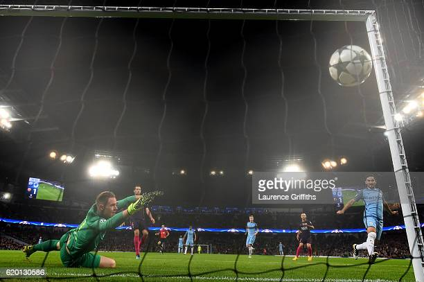 Ilkay Gundogan of Manchester City scores his sides first goal past MarcAndre ter Stegen of Barcelona during the UEFA Champions League Group C match...