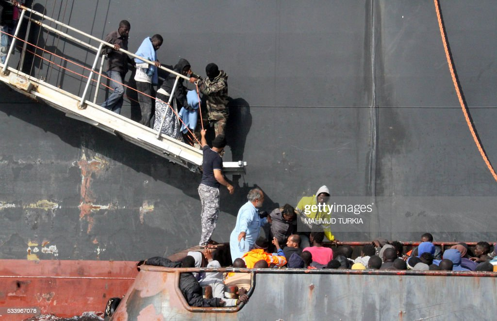 Illegal African migrants arrive by boat at the Zawiyah port, a Libyan naval base some 45 kilometres west of the capital Tripoli, after they were rescued off the western city of Sabratha on May 24, 2016 as they were trying to reach Europe by boat. Workers on a Libyan oil tanker helped to rescue 135 people from boats in the Mediterranean, an AFP journalist said, hours after coastguards detained 550 would-be migrants headed for Europe. Libyan coastguards earlier today that they had detained 550 people trying to reach Europe illegally by boat TURKIA