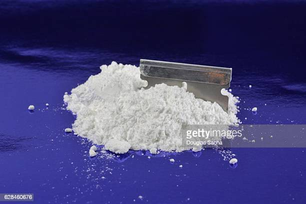 Illegal Drug in power form and a razor blade
