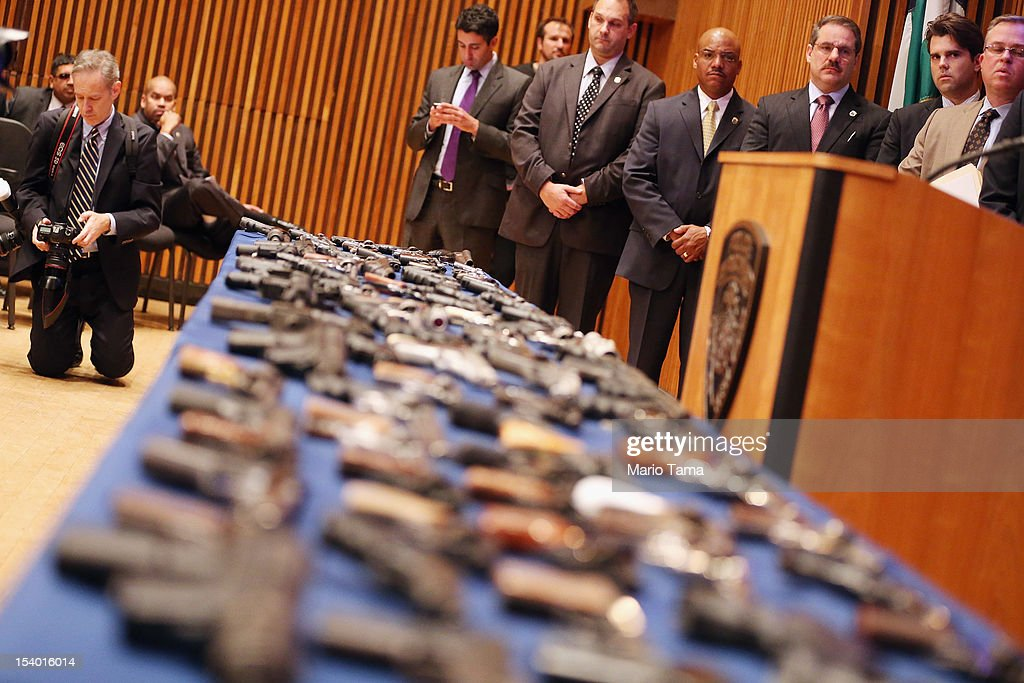 Illegal firearms sold to undercover officers in a large weapons bust in East Harlem are displayed on a table during a press conference on October 12, 2012 in New York City. NYPD detectives arrested 13 suspects for the illegal sale of 129 guns mostly purchased from gun dealers and pawn shops in South Carolina.