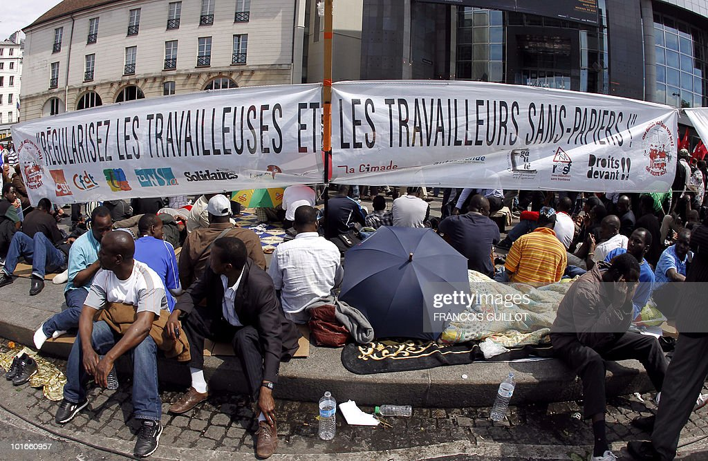 Illegal immigrant workers participate in a demonstration calling for their regularization on June 6, 2010 on the Bastille Square in Paris.