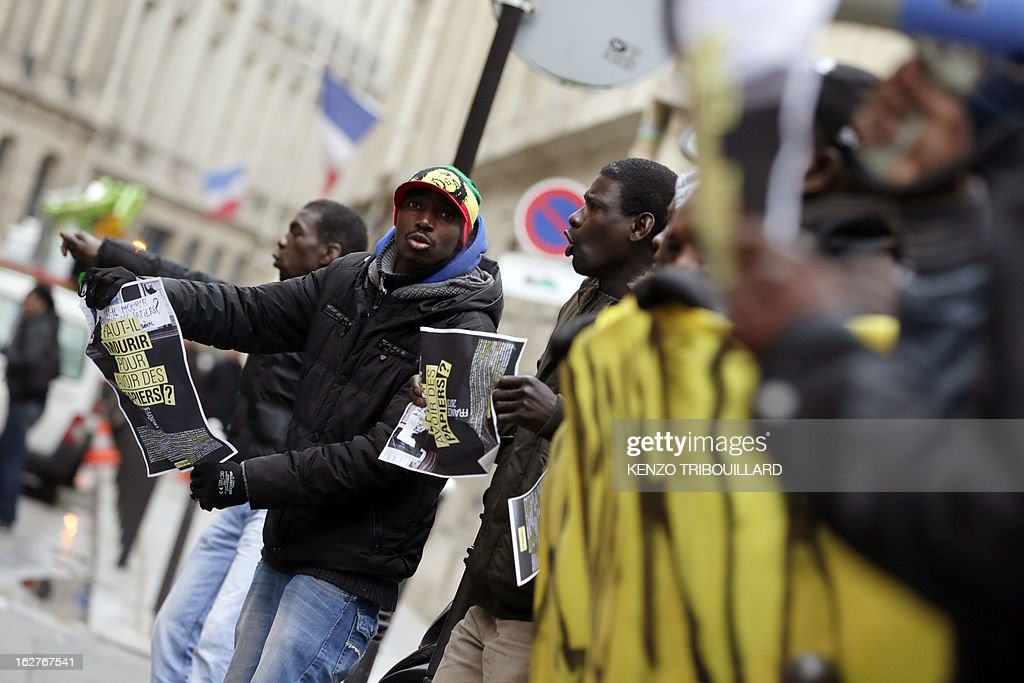 Illegal immigrants and militants demonstrate to call for the legalization of all undocumented immigrants in front of the Interior ministry on February 26, 2013 in Paris. AFP PHOTO KENZO TRIBOUILLARD