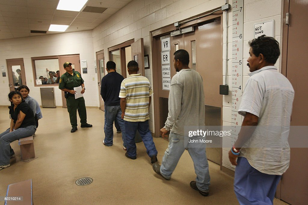 Illegal immigrants are processed at a US Border Patrol station after they were caught crossing from Mexico into the United States August 7 2008 near...