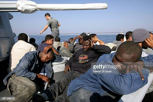 Illegal Immigrants are seen on a boat of Italian custom Police 'Guardia di Finanza' after they were taken on board on June 21 2005 in Lampedusa Italy...