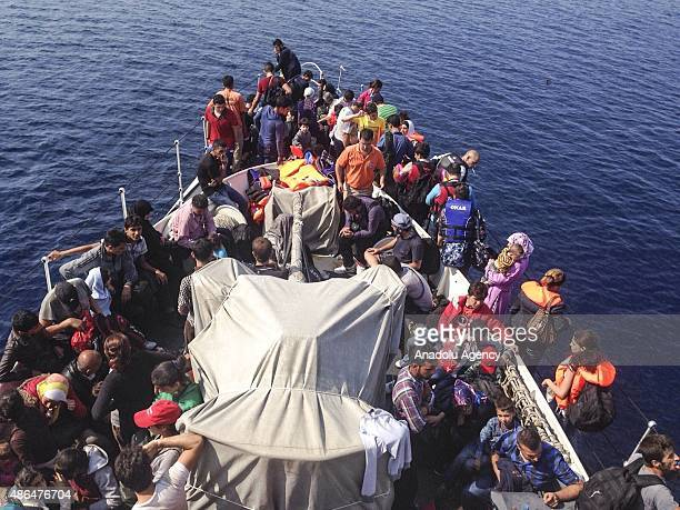 Illegal immigrants caught on the Aegean sea are seen on the Turkish Coast Guard boat in Izmir Turkey on September 4 2015 Turkish Coast Guard rescued...