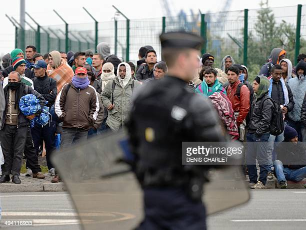Illegal immigrants wait to be expelled from their camp at Calais on May 28 2014 French police early Wednesday began expelling around 650 migrants...