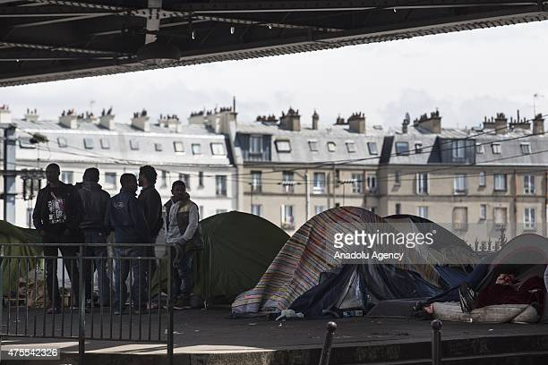 Illegal migrants are seen at an unauthorized migrant camp under the tracks of the Paris Metro Line 2 on Boulevard de la Chapelle in Paris France on...