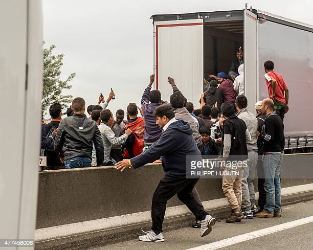 Illegal migrants attempt to hide in lorries heading for England in the French northern harbour of Calais on June 17 2015 AFP PHOTO / PHILIPPE HUGUEN