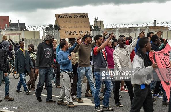 Illegal migrants demonstrate against British government on August 20 2015 in Calais on the occasion of the visit of Britain's Home Secretary visit to...