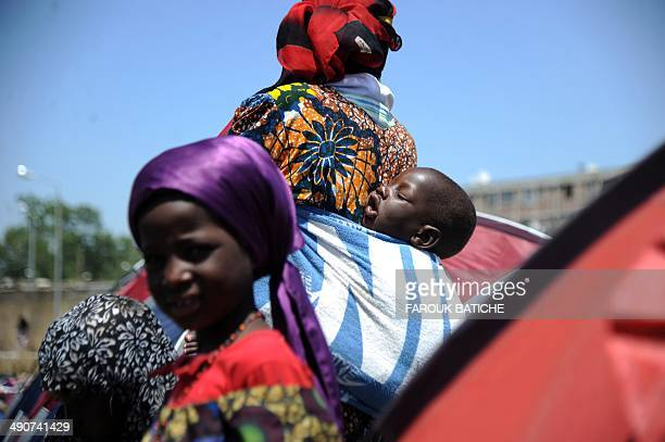 Illegal migrants from Niger stand next to their tents on May 14 2014 after settling some of them for more than one year near the fruit market in the...