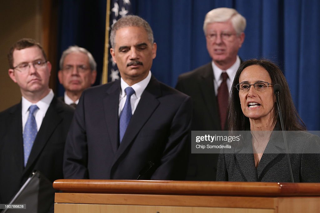 Illinois Attorney General <a gi-track='captionPersonalityLinkClicked' href=/galleries/search?phrase=Lisa+Madigan&family=editorial&specificpeople=2974155 ng-click='$event.stopPropagation()'>Lisa Madigan</a> (R) joins U.S. Attorney General <a gi-track='captionPersonalityLinkClicked' href=/galleries/search?phrase=Eric+Holder&family=editorial&specificpeople=1060367 ng-click='$event.stopPropagation()'>Eric Holder</a> and attorneys general from seven other states and the District of Columbia at the Department of Justice February 5, 2013 in Washington, DC. Holder announced that the United States is bringing a civil lawsuit against the ratings agency Standards & Poor's and its parent company, McGraw-Hill Companies, over its pre-fiscal crisis bond ratings.