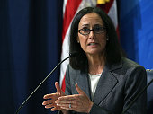 Illinois Attorney General Lisa Madigan speaks about a crackdown on deceptive and abusive debt collection practices during a news conference at the...