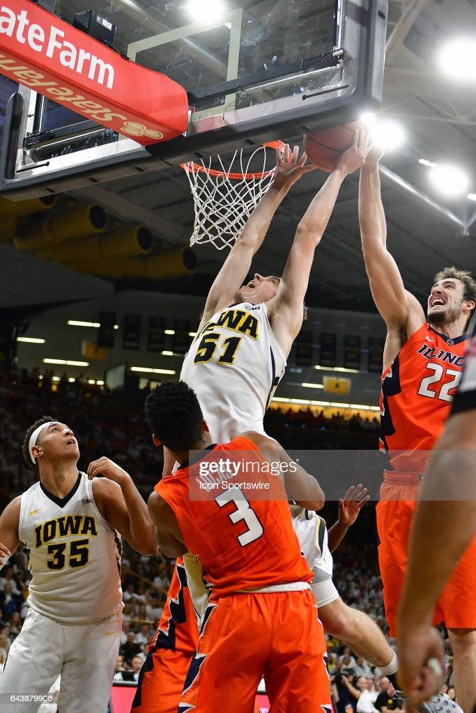 Illinois center Maverick Morgan (22) blocks a shot by Iowa Hawkeyes' forward Nicholas Baer (51) in the second half during a Big Ten Conference basketball game between the University of Illinois Fighting Illini and the University of Iowa Hawkeyes on February 18, 2017, at Carver-Hawkeye Arena in Iowa City, IA.