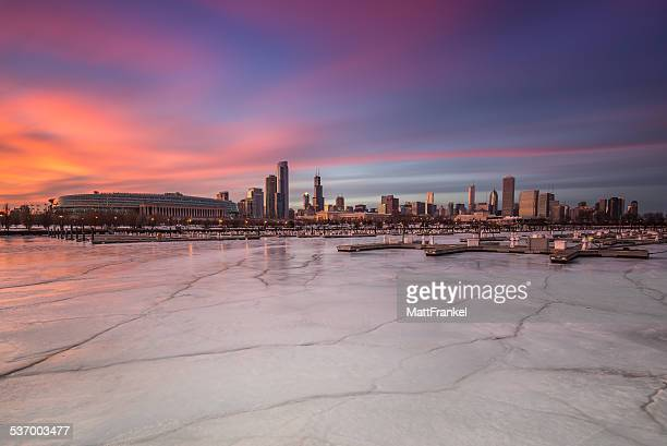 USA, Illinois, Chicago, Northerly Island, Downtown skyline seen from frozen lake at sunset
