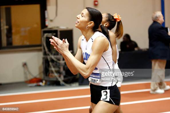 Illinois College's Melissa Norville applauds the results on the scoreboard as she finds out she won the women's 60m Hurdles at the Division III Men's...