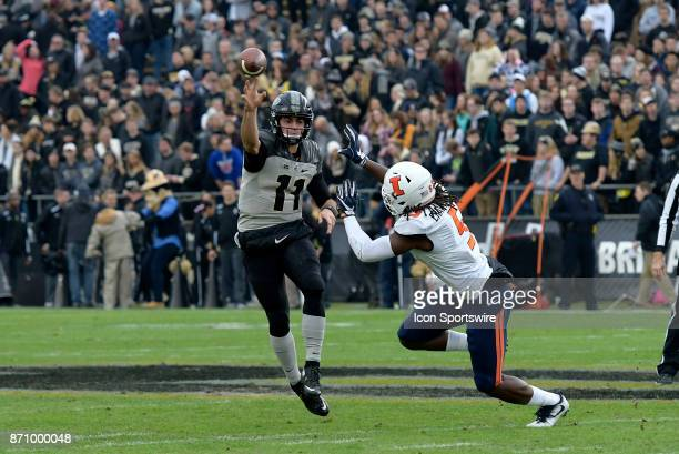 Illinois Fighting Illini defensive lineman James Crawford flushes Purdue Boilermakers quarterback David Blough out of the pocket during the Big Ten...