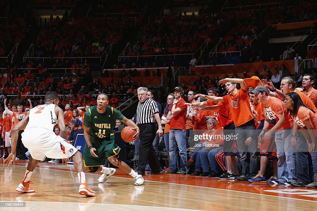 Illinois Fighting Illini fans try to distract Pendarvis Williams #11 of the Norfolk State Spartans as he brings the ball up court during the game at Assembly Hall on December 11, 2012 in Champaign, Illinois. Illinois won 64-54.