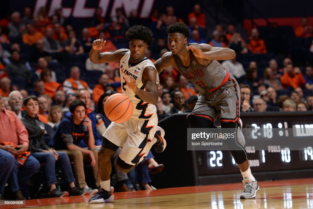 Illinois Fighting Illini forward Kipper Nichols (2) and Austin Peay Governors Guard Terry Taylor (21) chase after a loose ball during the college basketball game between the Austin Peay Governors and the Illinois Fighting Illini on December 6, 2017, at the State Farm Center in Champaign, Illinois.