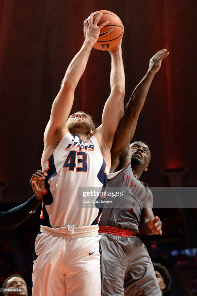 Illinois Fighting Illini forward Michael Finke (43) comes down with a rebound during the college basketball game between the Austin Peay Governors and the Illinois Fighting Illini on December 6, 2017, at the State Farm Center in Champaign, Illinois.