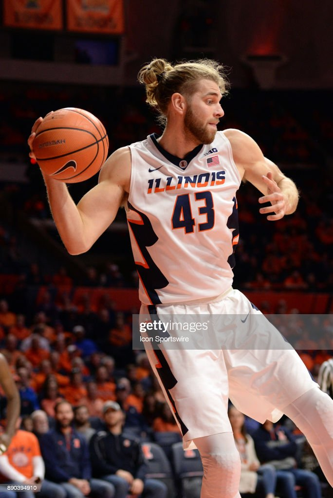 Illinois Fighting Illini forward Michael Finke (43) saves the ball from going out of bounds during the college basketball game between the Austin Peay Governors and the Illinois Fighting Illini on December 6, 2017, at the State Farm Center in Champaign, Illinois.