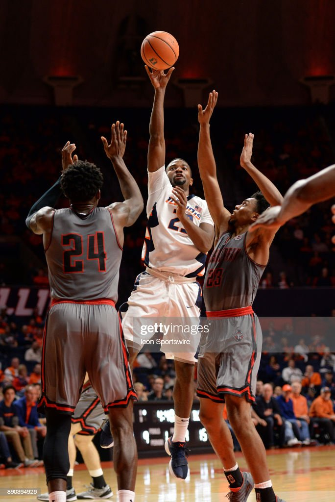 Illinois Fighting Illini guard Aaron Jordan (23) shoots the ball over the defense of the Austin Peay Governors during the college basketball game between the Austin Peay Governors and the Illinois Fighting Illini on December 6, 2017, at the State Farm Center in Champaign, Illinois.