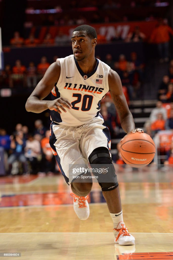 Illinois Fighting Illini guard Da'Monte Williams (20) dribbles to the basket during the college basketball game between the Austin Peay Governors and the Illinois Fighting Illini on December 6, 2017, at the State Farm Center in Champaign, Illinois.