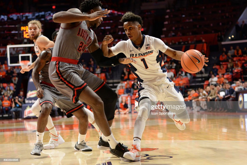 Illinois Fighting Illini guard Trent Frazier (1) dribbles into Austin Peay Governors Forward Averyl Ugba (24) during the college basketball game between the Austin Peay Governors and the Illinois Fighting Illini on December 6, 2017, at the State Farm Center in Champaign, Illinois.