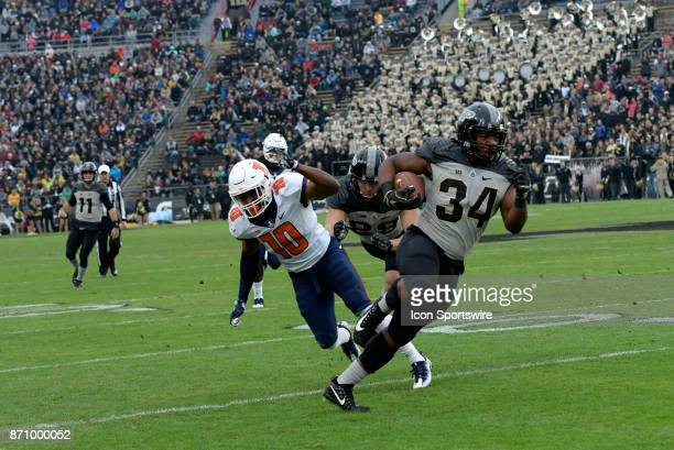 Illinois Fighting Illini linebacker James Knight just misses making a tackle as Purdue Boilermakers running back Richie Worship runs into the open...