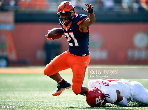 Illinois Fighting Illini running back Ra'Von Bonner is tackled by Rutgers Scarlet Knights defensive back Isaiah Wharton during the game between the...