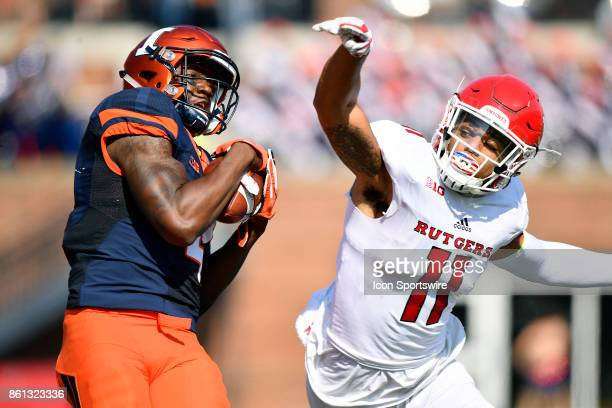 Illinois Fighting Illini wide receiver Ricky Smalling catches the ball while defended by Rutgers Scarlet Knights defensive back Isaiah Wharton during...