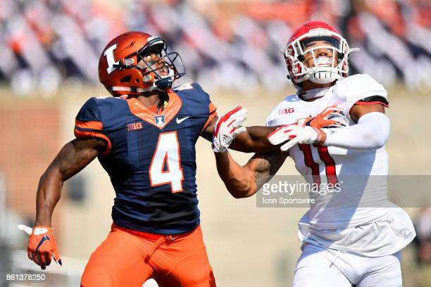 Illinois Fighting Illini wide receiver Ricky Smalling looks for the ball while being defending by Rutgers Scarlet Knights quarterback Johnathan Lewis...
