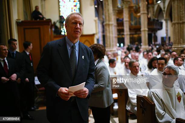 Illinois Governor Bruce Rauner attends the funeral Mass of Cardinal Francis George on April 23 2015 in Chicago Illinois George died on April 17 after...