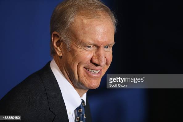 Illinois governor Bruce Rauner waits for the arrival of President Barack Obama at the Gwendolyn Brooks College Preparatory Academy on February 19...