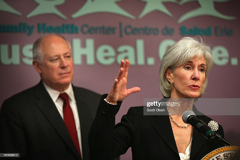 Illinois Governor Pat Quinn listens while Health and Human Services Secretary Kathleen Sebelius speaks during a press conference at the Erie Family Health Center on February 13, 2013 in Chicago, Illinois. Sebelius and Quinn used the opportunity to promote cooperation between states and the federal government in the implementation of the Affordable Care Act.