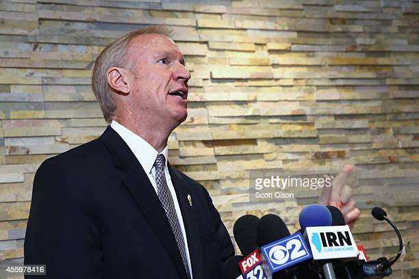 Illinois gubernatorial candidate Bruce Rauner leaves a campaign event on September 23 2014 in Chicago Illinois Christie who heads the Republican...