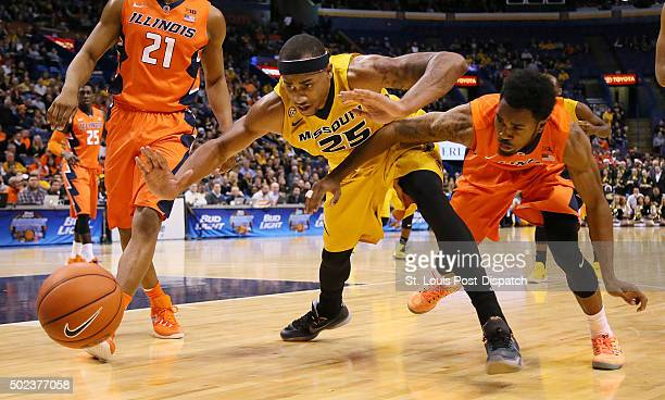 Illinois' Jaylon Tate right forces a turnover by Missouri's Russell Woods in the first half on Wednesday Dec 23 at the Scottrade Center in St Louis...