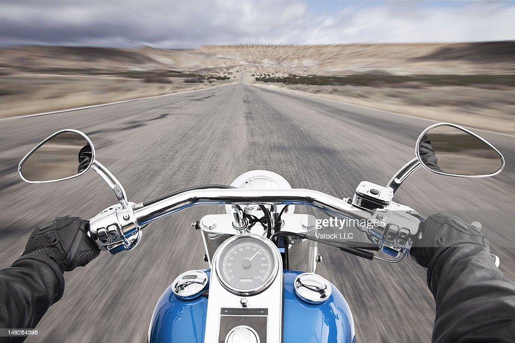 USA, Illinois, Metamora, Biker's hands on handlebar during driving