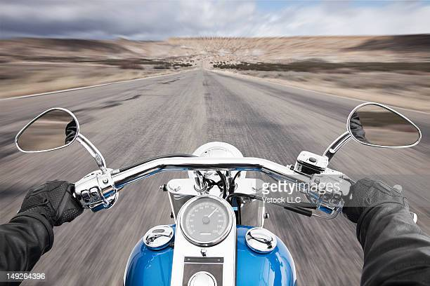 USA, Illinois, Metamora, Biker's hands on handlebar during driving