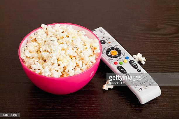 USA, Illinois, Metamora, Bowl of popcorn and remote control on table