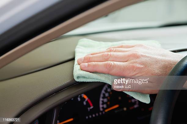 USA, Illinois, Metamora, Close up of man's hand cleaning car dashboard