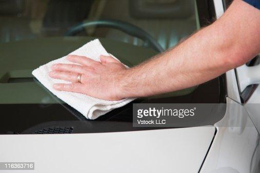 USA, Illinois, Metamora, Close up of man's hand washing car windshield