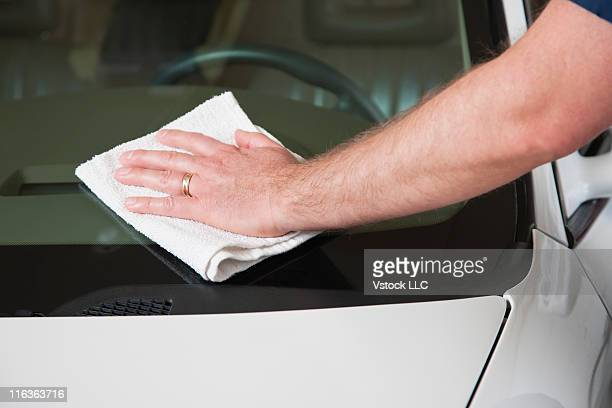 USA, Illinois, Metamora, Close up of man's hand washing car windshield
