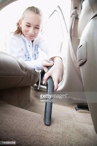 USA, Illinois, Metamora, Close-up of girls (12-13) hand cleaning car interior