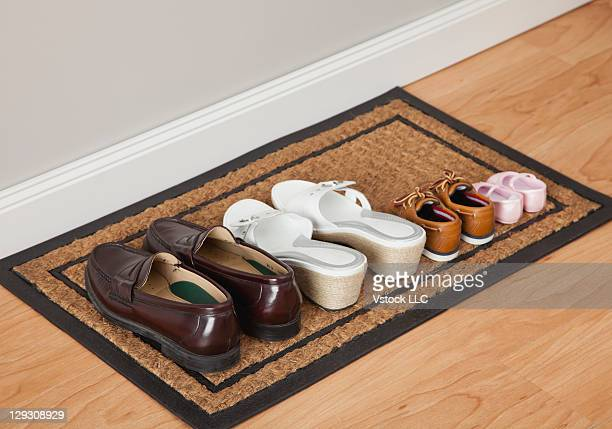 USA, Illinois, Metamora, Family shoes on door mat