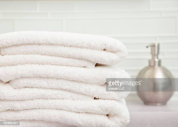 USA, Illinois, Metamora, focus on stack of towels in bathroom