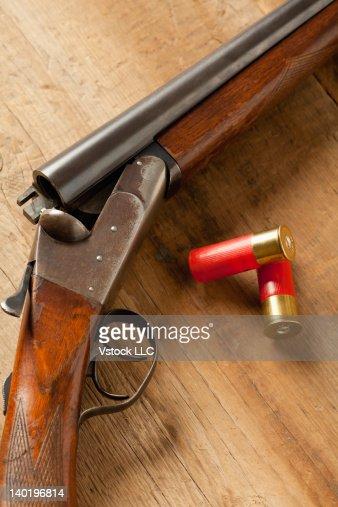 USA, Illinois, Metamora, Gun and bullets on table