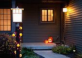 USA, Illinois, Metamora, Jack o' lanterns on porch
