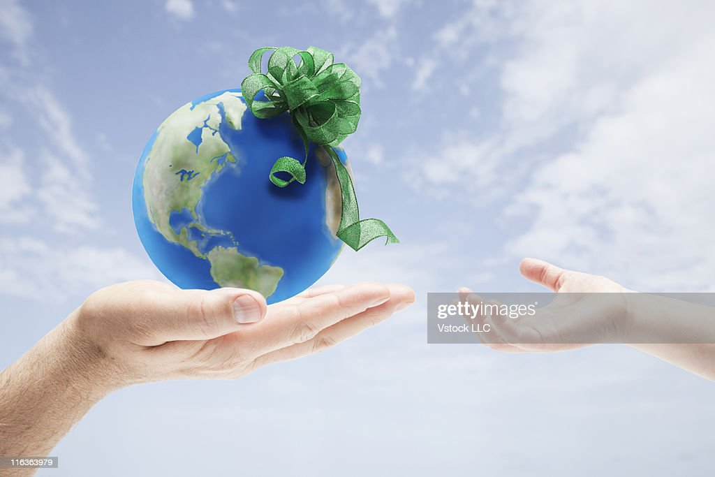 USA, Illinois, Metamora, Man giving globe to girl (4-5) : Stock Photo